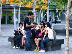 Teenagers using mobiles